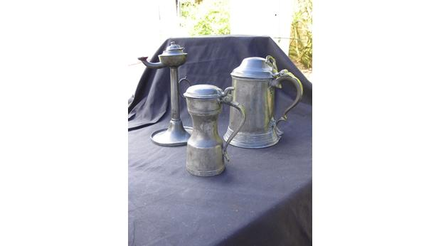 Pewter tankards and lamp