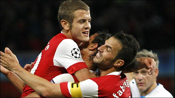 Marouane Chamakh celebrates scoring his goal with Jack Wilshere and Cesc Fabregas