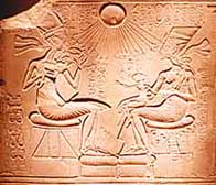 Akhenaten and Nefertiti playing with their daughters beneath the Aten
