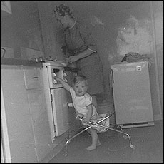 Woman and baby in a kitchen