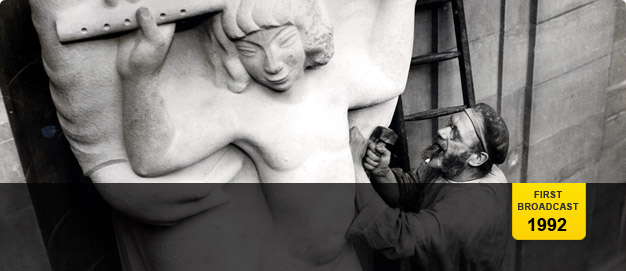 Eric Gill sculpting 'Prospero and Ariel'.