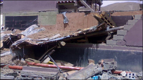 Destroyed houses fill the street after an earthquake hit northwest China's Qinghai province on Wednesday April 14 2010