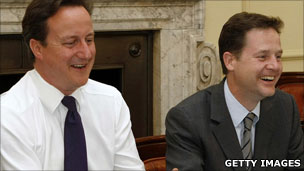 David Cameron and Nick Clegg sitting in the Cabinet room