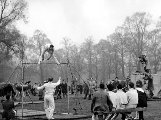A gymnast from the British Olympic team trains in Hyde park.