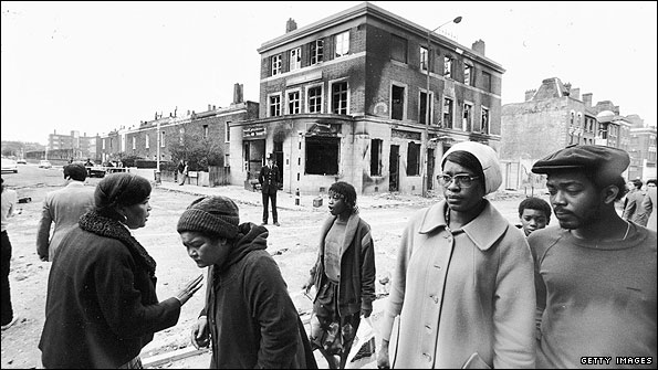 Burnt out buildings in Brixton, April 1981