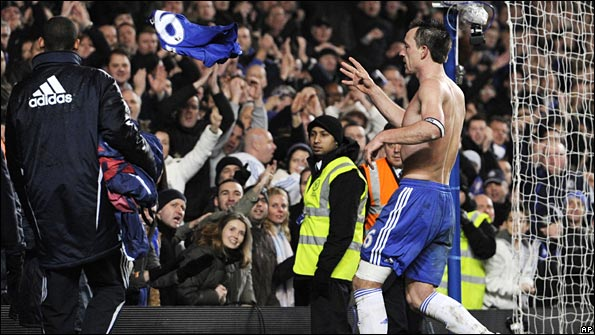 John Terry throws his Chelsea shirt into the crowd