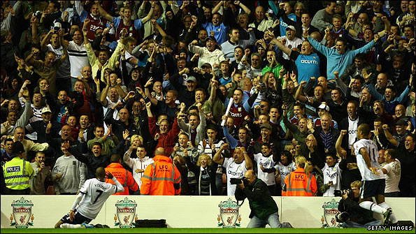 Young celebrates with the Aston Villa fans, who came under criticism from O'Neill