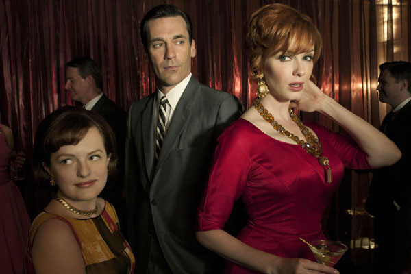 Peggy Olson, played by Elizabeth Moss, Don Draper, played by Jon Hamm, and Joan Harris, played by Christina Hendricks, in Mad Men