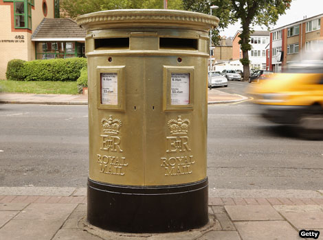 A gold post box in Isleworth, London.