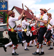 Bbc religions paganism history of modern paganism morris dancers in traditional costumes hats and shoes publicscrutiny Images