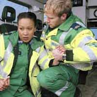 A man and a woman dressed in paramedic uniforms