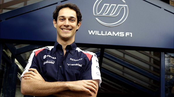 Bruno Senna posing with a Williams logo