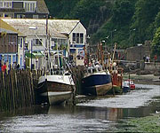 When the tide at Looe harbour goes out, it can only accommodate smaller boats