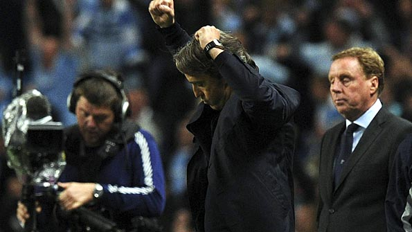 Mancini punches the air during City's win over Spurs. Photo: Reuters