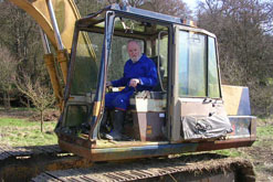 Richard Stilgoe and his digger
