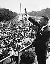 Martin Luther King waves to the crowd of more than 200,000 people gathered on the Mall during the March on Washington, after delivering his 'I Have A Dream' speech