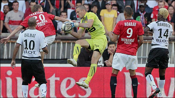 Rennes goalkeeper Nicolas Douchez catches the ball against PSG