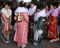 Japanese girls in furisode kimonos and traditional shoes at a Seijin Shiki celebration