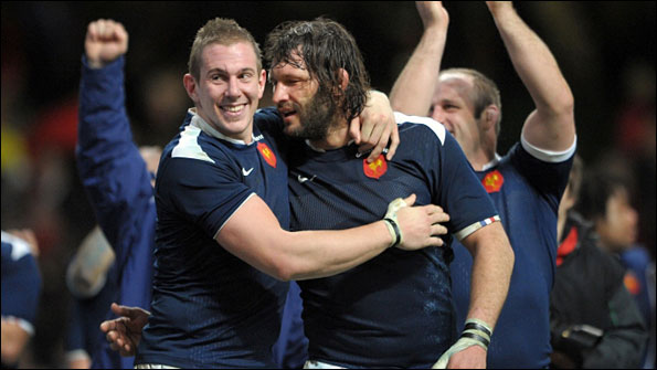 Flanker Imanol Harinordoquy and lock Lionel Nallet celebrate after France's victory in Cardiff