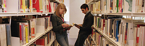 people reading in library