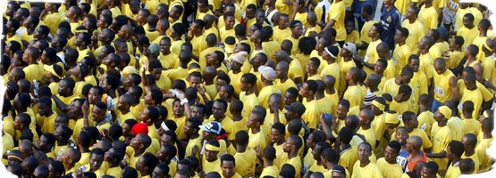 A young crowd of young Africans in yellow t-shirts