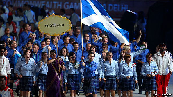 Scotland flag bearer Ross Edgar leads the team at the Commonwealth Games opening ceremony
