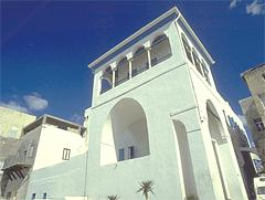 Bahá'u'lláh's house, a white building with wide archways