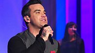 Robbie Williams performs his new single