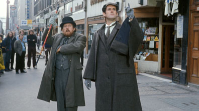 Rushton and Cleese as Watson and Holmes