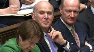 Business Secretary Vince Cable watches the Chancellor deliver the Budget