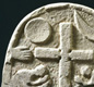 A Viking grave marker, from Lindisfarne in Northumbria. Notice the Christian cross.