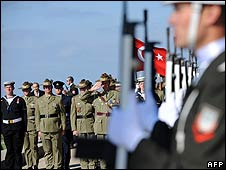 Turkish and Australian soldiers celebrate Anzac Day