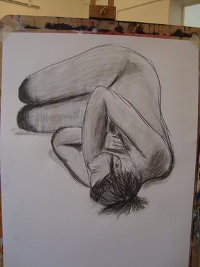 Life drawing of model curled into ball