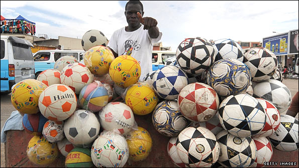 Street vendor sells footballs during Africa Cup of Nations