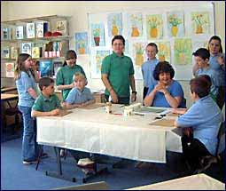 Image of children around a table