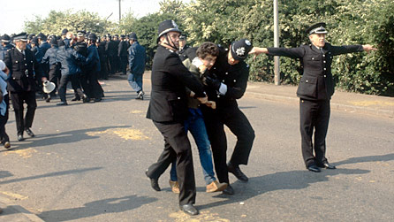Two policemen arresting a miner at Orgreave