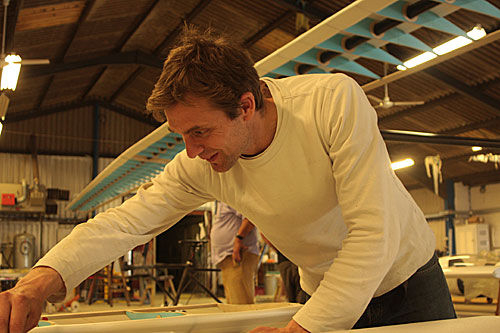 Jem Stansfield works on a part of the wing of the plane in the aircraft hangar.