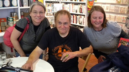 Phil Rickman with fans at a book-signing