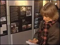 The exhibition features photos and letters from those who died