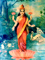 The goddess Lakshmi in a red sari, standing on a lotus flower on a lake, being anointed with water by a white elephant