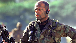 Despite copious camouflage, Bruce Willis still couldn't hide from Antoine Fuqua on the Tears Of The Sun set