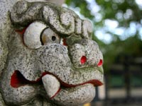 Temple tiger statue, with eyes and mouth painted to make him look ferocious © iStockphoto/Sigi Goode