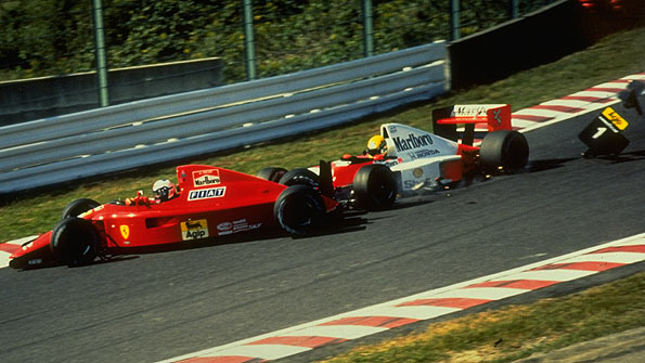 Ayrton Senna crashes into Alain Prost at the start of the 1990 Japanese Grand Prix