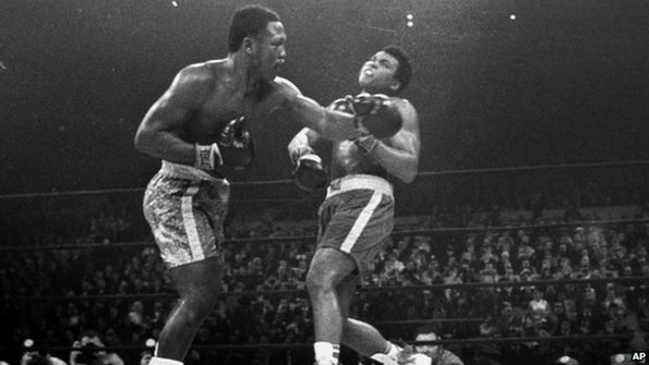 Joe Frazier hits Muhammad Ali with a left during the 15th round of their heavyweight title fight at New York's Madison Square Garden on March 8, 1971