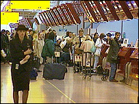 People at airport check-in desks