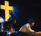 Justice performing live at Radio 1's Big Weekend 2008 with an enormous cross as a backdrop
