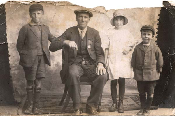 A Century Of Fatherhood: left to right - Alec Haines with his dad, brother and sister