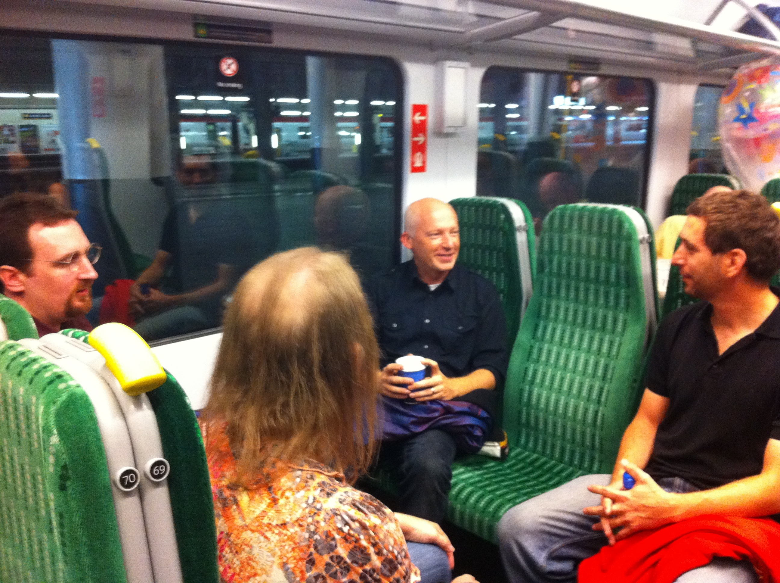 The three Code finalists on the train with Marcus du Sautoy