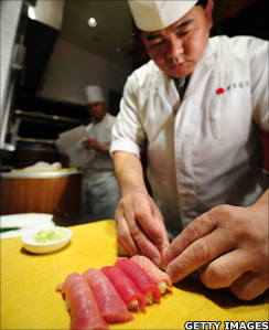 Sushi chef prepares sushi from a bluefin tuna