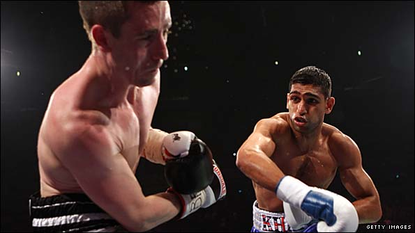 Khan (right) beat McCloskey on points